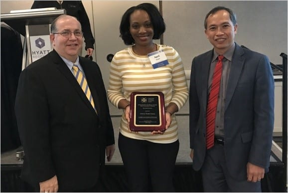 Mitchel Rothholz and L.J. Tan present April Green of Oschner and Associates with the Adult Immunization Champion Award. Courtesy of National Adult and Influenza Immunization Summit